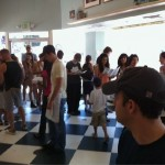 A crowd of people inside the Magnolia Bakery on 3rd Street, shortly after it opened today. (Photo: Jason Cochran)