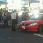 Crowd on scene around car after a vehicle hit a pedestrian on Melrose Ave (photo: Anthony Holguin for Weho Daily)