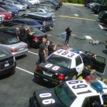A news crew proned out on the ground in the Sunset Plaza parking lot. (Photo: Brittany Joe)