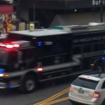 LAPD SWAT bus rushes down Sunset Blvd towad Laurel Canyon (Photo: Alli White for Weho Daily)