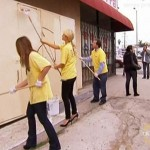 In a scene from her new reality show, Paris Hilton painting over graffiti as part of a public service court requirement.
