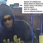 "The ""Tourist Bandit"" shown robbing the Bank of America on Santa Monica Blvd. in security camera footage."
