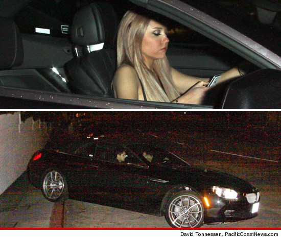 Amanda Bynes texting behind the wheel and running her car up onto the curb on Sunset near Chateau Marmont.