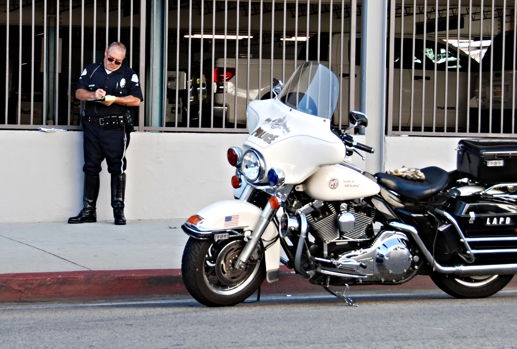 LAPD police officer issuing a traffic ticket.