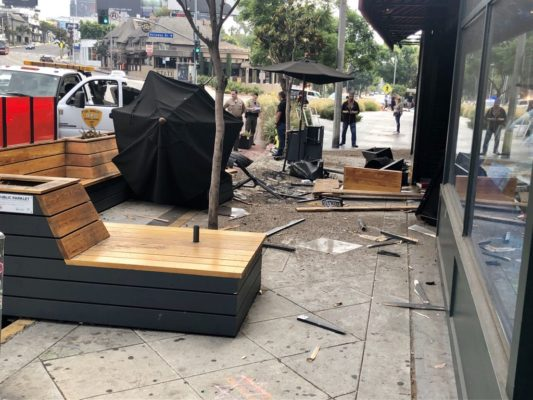 Aftermath of traffic crash into parklet in front of BookSoup (credit: @socalgecko for WeHoDaily)