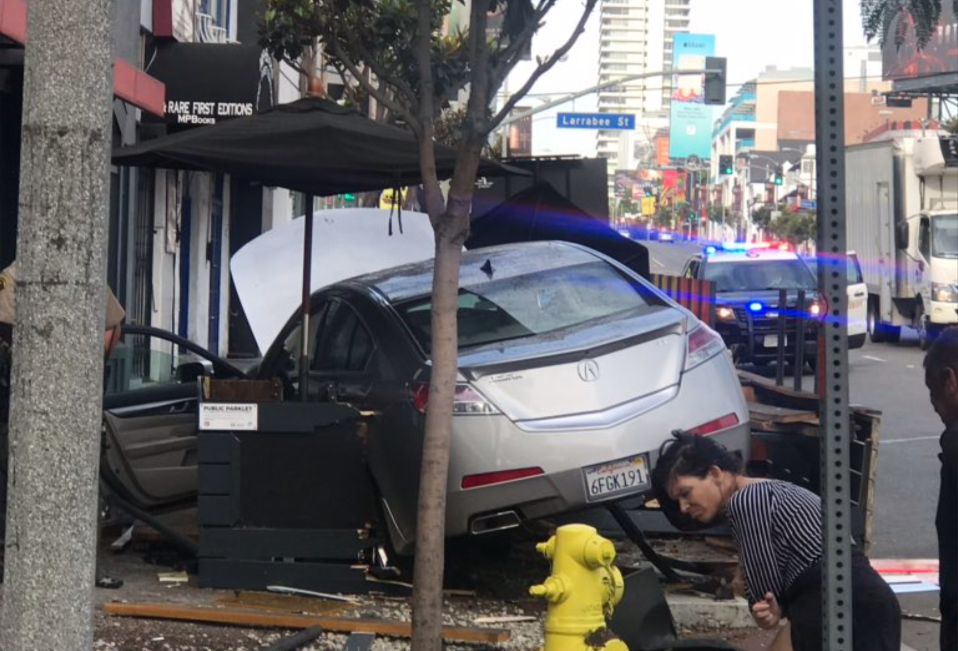 Car demolished a parklet on Sunset in front of BookSoup (credit: a reader for WeHoDaily)